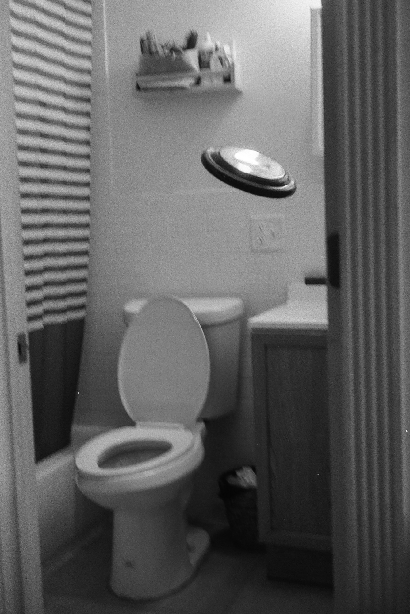 """toilet, sink, frisbee,"" 35mm B/W film, Tunnel Vision (2020)"